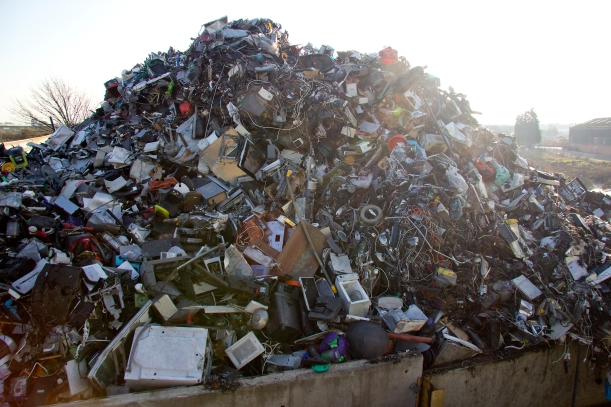 Waste Electrical and Electronic Equipment piles up before being processed.