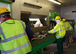 Staff at SWEEEP sort and process the electronic waste off conveyor belts.