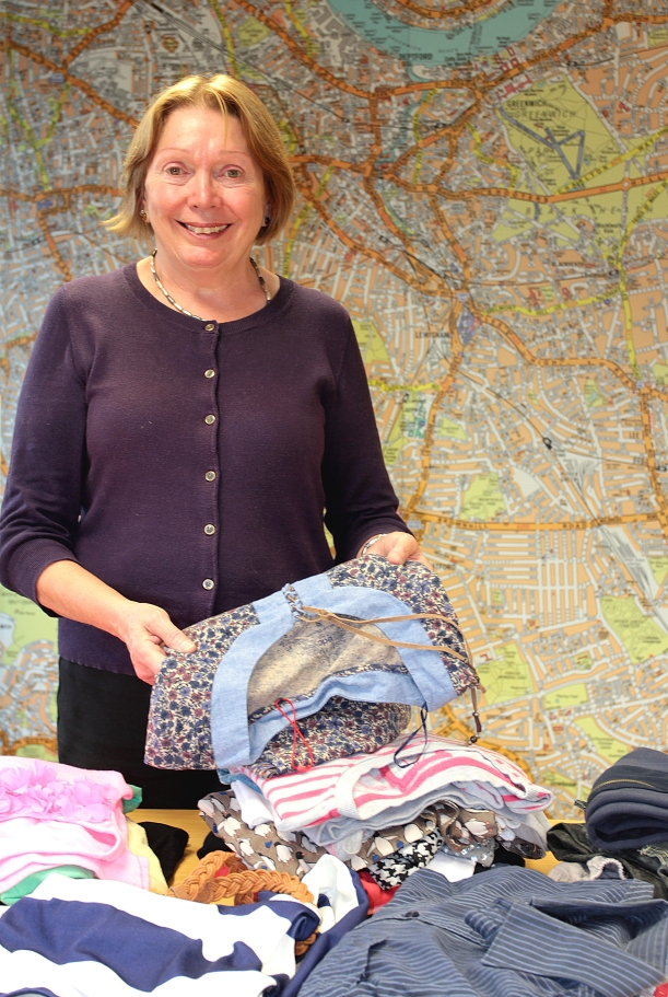 Councillor Susan Wise helps with sorting clothes for the swishing event.