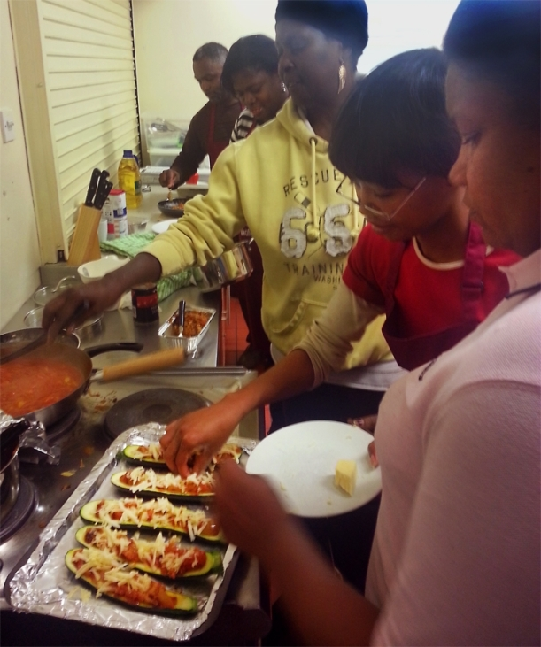Lewisham residents about to enjoy the fruits of their labour. New recipes learnt in the first of Honor Oak Community Centre and Lewisham Councils  Love Food Hate Waste cooking class.