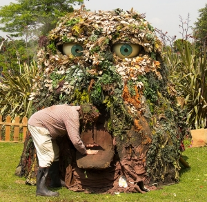 A disgruntled gardener has a closer look at the large compost heap