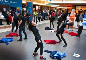 The flab mob start their routine as curious shoppers try to work out what is going on