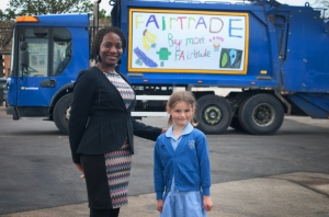Winner of the Fairtrade poster competition, Isla Prosser stands proudly infront of her art work with Cllr Onikosi