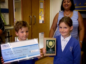 Pupils Isla Prosser and James Galbraith receiving their awards